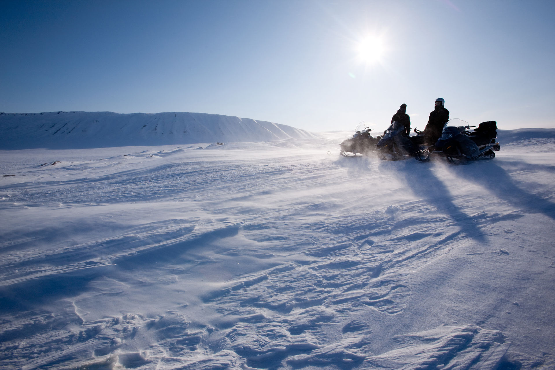 Winter fishing with snowmobile - Wilderness adventure